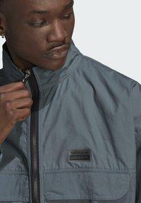 adidas Originals - FASHION TT - Training jacket - blue - 4