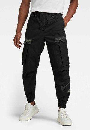FLIGHT RCT CARGO - Cargo trousers - dk black