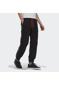 adidas Originals - CAMO JOGGERS - Tracksuit bottoms - black - 3