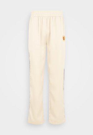 ACADEMY CREST TRACK PANT UNISEX - Pantalon de survêtement - notebook white