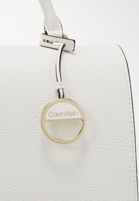 Calvin Klein - SIDED TOP HANDLE - Handbag - white - 3