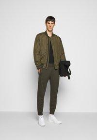 Emporio Armani - JEZZ - Trousers - dark green - 1