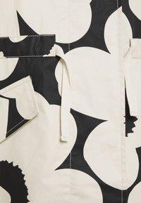 Marimekko - ROHKAISTA UNIKKO COAT - Classic coat - black/off-white - 2