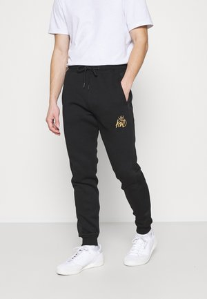 CANEYJOGGER - Trainingsbroek - black/gold