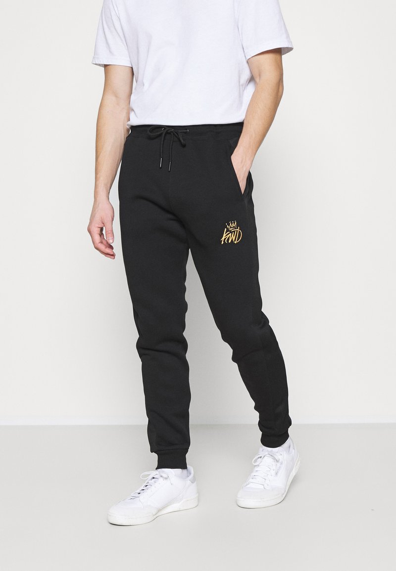 Kings Will Dream - CANEYJOGGER - Pantaloni sportivi - black/gold