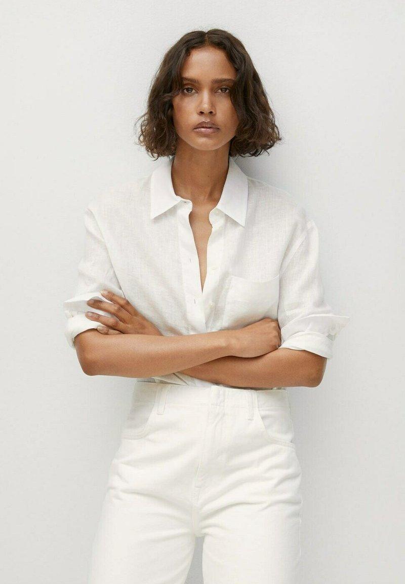 Mango - Button-down blouse - cremeweiß