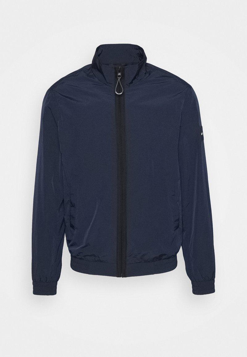 Calvin Klein - CRINKLE EASY  - Light jacket - blue