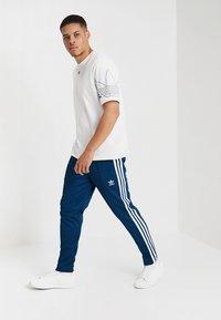 adidas Originals - BECKENBAUER - Tracksuit bottoms - legmar - 1