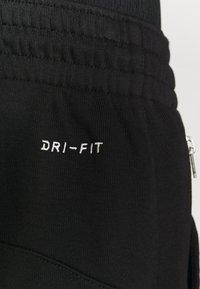 Nike Performance - STANDARD ISSUE PANT - Teplákové kalhoty - black/pale ivory/pale ivory - 4
