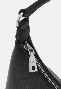 DKNY - CAROL POUCHETTE - Handbag - black/silver-coloured - 0