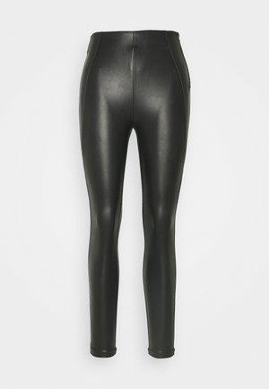 VIANNAS COATED - Leggings - Trousers - black
