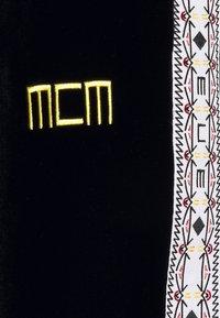 MCM - GEO LAUREL TRACK PANT IN VELOUR - Tracksuit bottoms - black - 2
