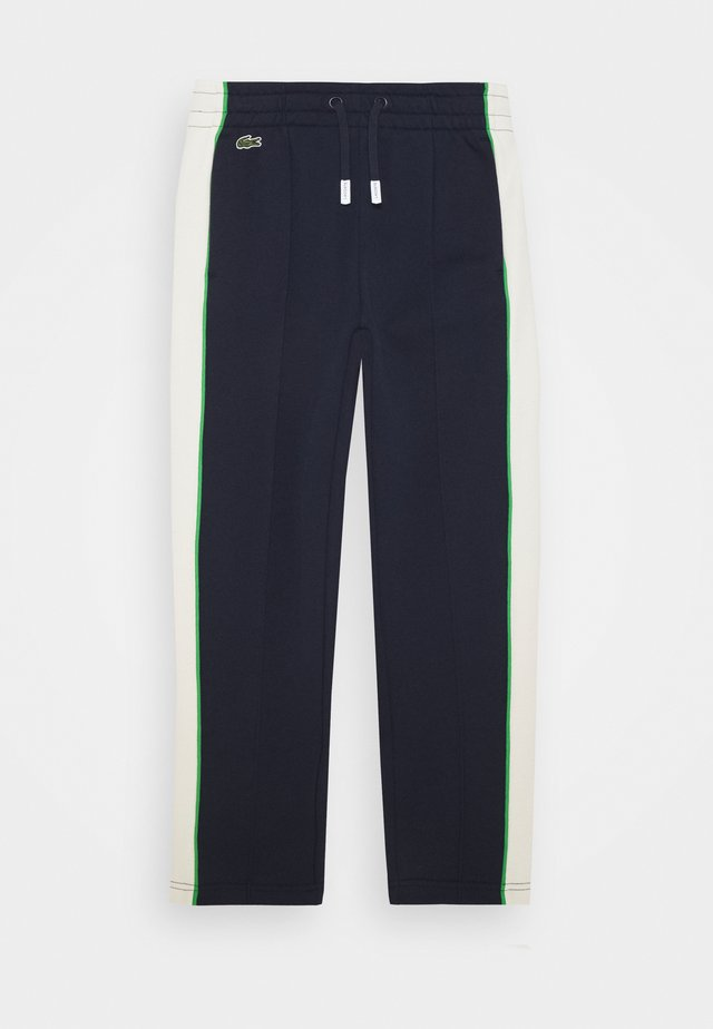 Tracksuit bottoms - navy blue/flour chervil