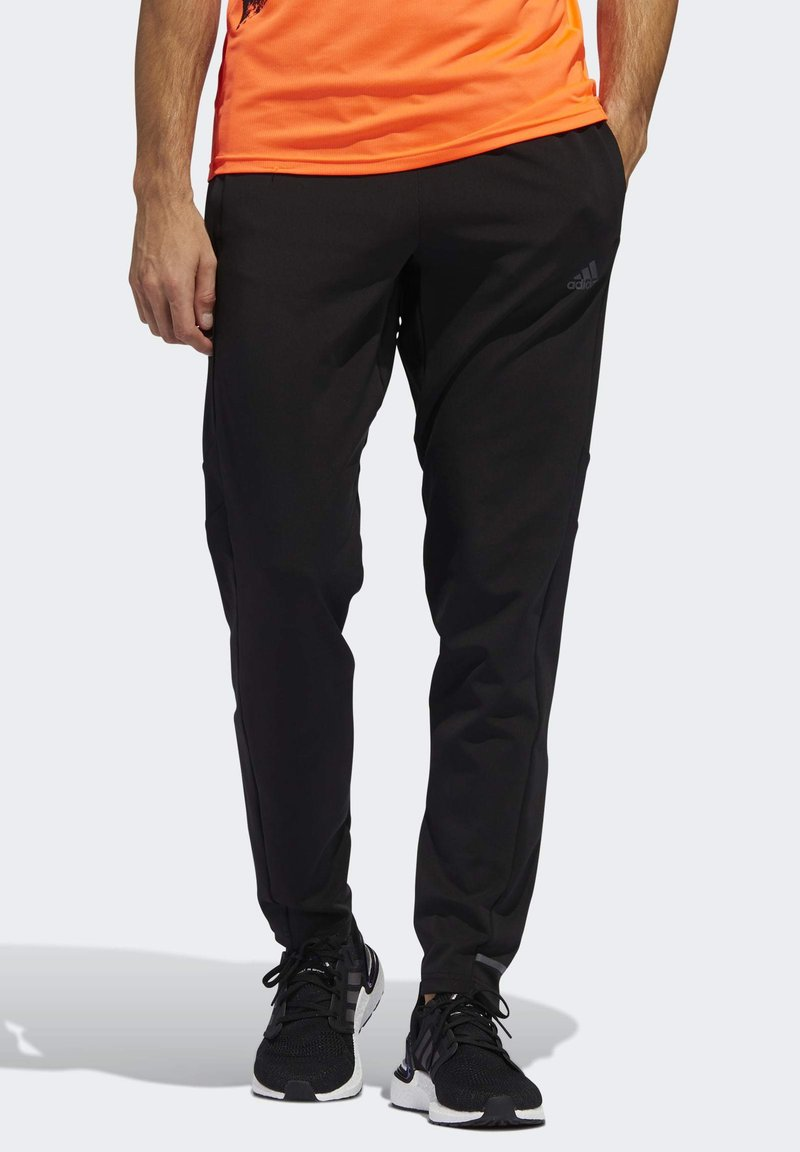 adidas Performance - OWN THE RUN ASTRO JOGGERS - Tracksuit bottoms - black