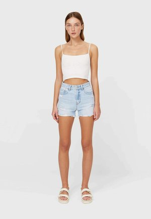 MIT RISSEN  - Denim shorts - mottled blue