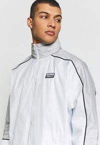 adidas Originals - R.Y.V. SPORT INSPIRED TRACK TOP JACKET - Wiatrówka - offwhite - 3