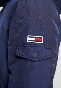 Tommy Jeans - TECH JACKET - Winter jacket - black iris - 8