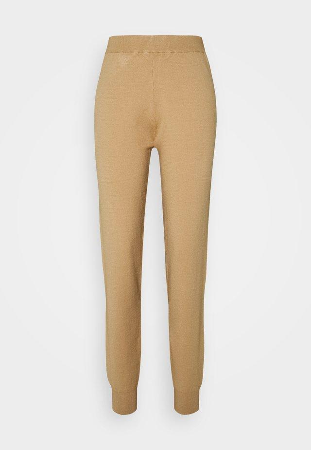 RAQUEL PANTS - Pantalones deportivos - tannin