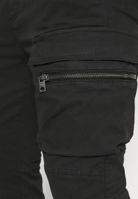 Tigha - FRYCO - Cargo trousers - vintage black - 6