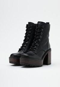 Jonak - KALI - Platform ankle boots - noir - 2