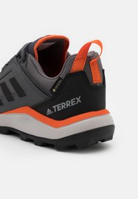 adidas Performance - TERREX AGRAVIC GORE-TEX RUNNING - Trail running shoes - grey four/core black/orange - 5