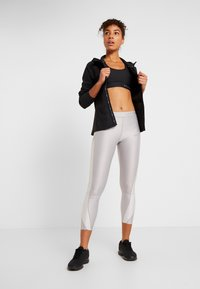 Under Armour - OUTRUN THE STORM  - Sports jacket - black - 1