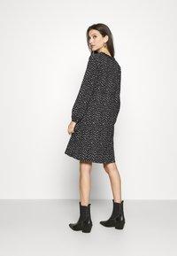 ONLY - ONLZILLE FRILLNECK DRESS  - Kjole - black/white ditsy - 2