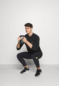 adidas Performance - ULTRA PANT - Trainingsbroek - black/yellow - 1