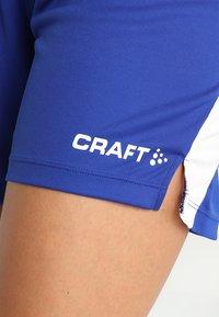 Craft - PROGRESS SHORT CONTRAST - Teamwear - cobalt/ white - 5