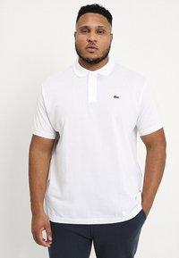 Lacoste - Poloshirt - blanc - 0