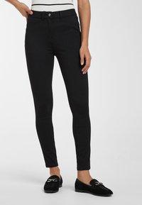 Next - BLACK FLY FASTEN JERSEY DENIM LEGGINGS - Jeans Skinny Fit - black - 0