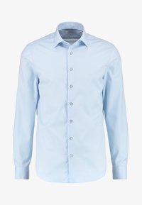 Camisa - soft blue