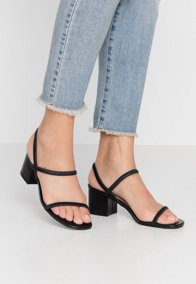 INESSA - Sandaalit nilkkaremmillä - black