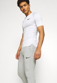 Nike Performance - PANT TAPER - Tracksuit bottoms - dark grey heather/black - 3