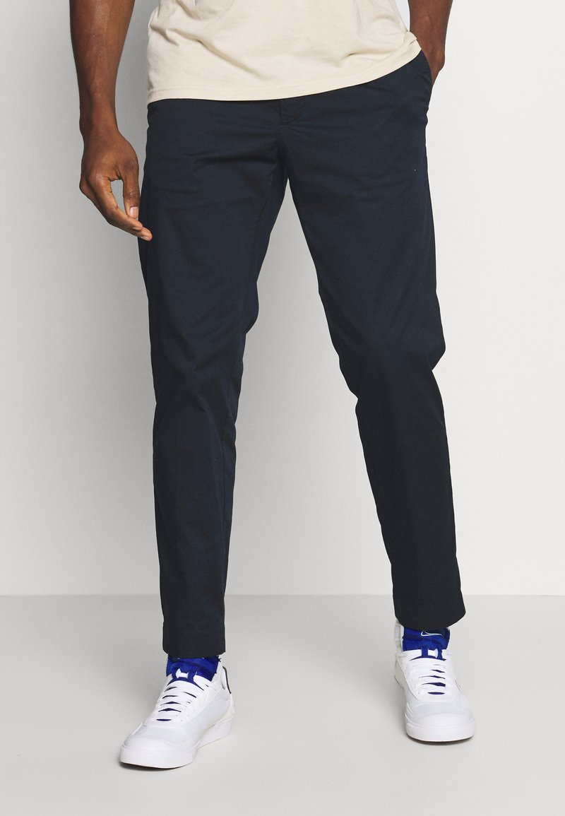 Tommy Hilfiger - ACTIVE PANT SUMMER FLEX - Trousers - blue
