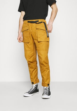 PANELED JOGGER - Cargo trousers - dark soba