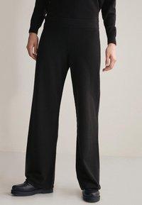 Falconeri - PALAZZO - Trousers - black - 0