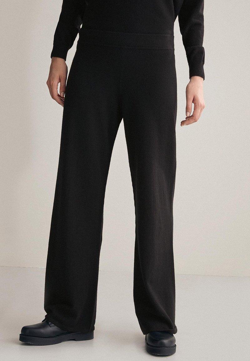 Falconeri - PALAZZO - Trousers - black
