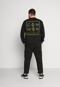 Common Kollectiv - ZONE LONGSLEEVE - Long sleeved top - black - 2