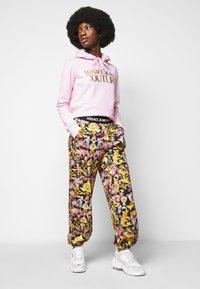 Versace Jeans Couture - JOGGERS - Spodnie treningowe - black - 3