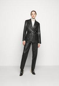 Alberta Ferretti - Leather trousers - black - 1