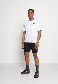 Calvin Klein Jeans - LOGO - Tracksuit bottoms - black - 1