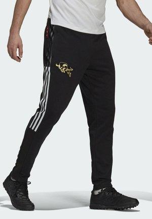 MANCHESTER UNITED CNY SW PNT - Tracksuit bottoms - black