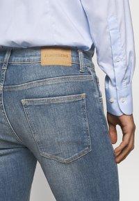 J.LINDEBERG - JAY ACTIVE - Jeans slim fit - light blue - 5