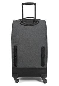 Eastpak - TRANS4 M CORE COLORS  - Wheeled suitcase - black denim - 3
