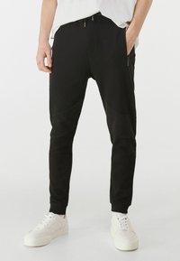 Bershka - Pantalon de survêtement - black - 0