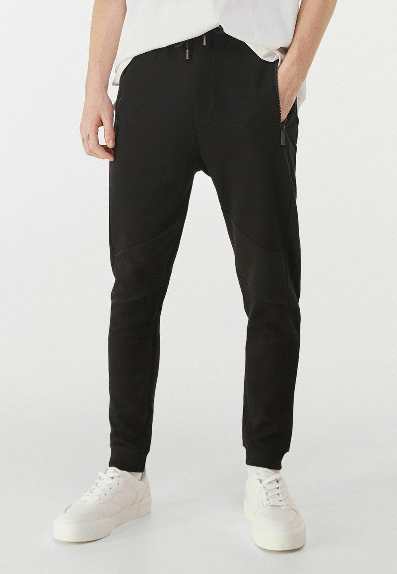 Bershka - Pantalon de survêtement - black
