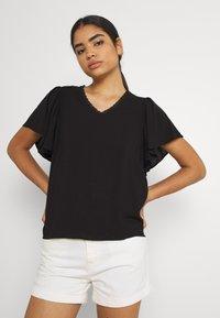 Vero Moda - VMNADS TRAPEZ SLEEVE - Print T-shirt - black - 0
