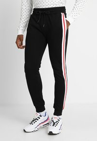 Urban Classics - TERRY TONE SIDE STRIP PANTS - Tracksuit bottoms - black/white/firered - 0