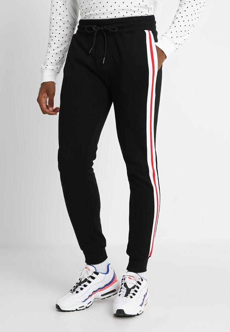 Urban Classics - TERRY TONE SIDE STRIP PANTS - Tracksuit bottoms - black/white/firered